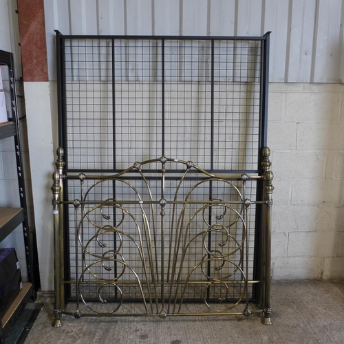 3056 - A kingsize metal frame bed - no fixings...