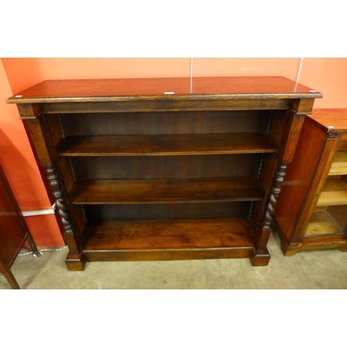 67 - A Victorian oak open bookcase...