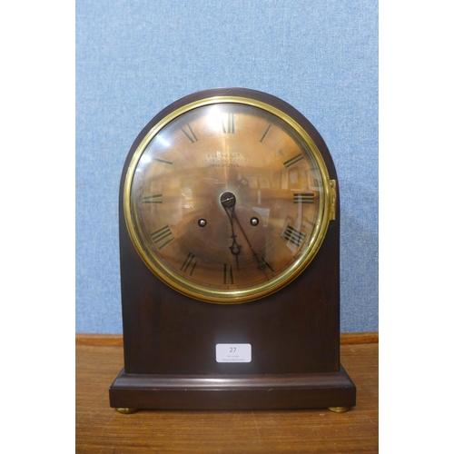 27 - A 19th Century mahogany bracket clock, the brass dial bearing Russells Ltd., 10 Exchange Street, Man...