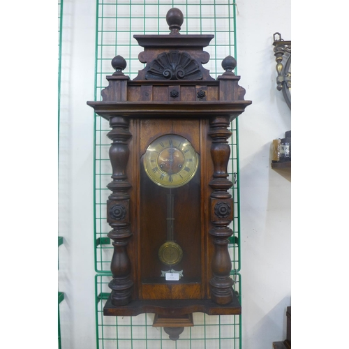 29 - A 19th Century walnut Vienna wall clock...