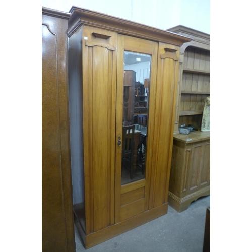 41 - A Victorian satin birch wardrobe...