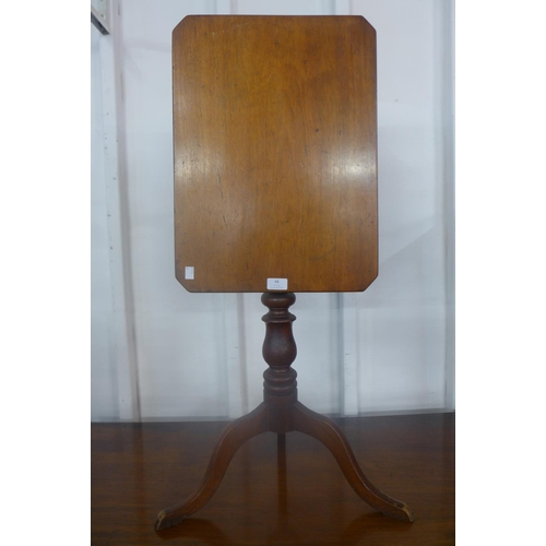 48 - A Victorian mahogany rectangular tilt-top tripod table...