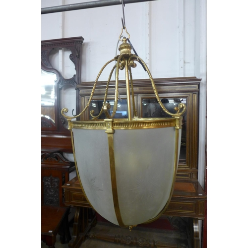 59a - A large gilt metal and glass hanging ceiling pendant light, approx. 97cms h...