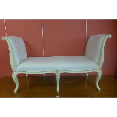 61 - A French Louis XV style cream and upholstered window seat...