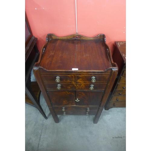 65 - A George III inlaid mahogany gentleman's night stand...