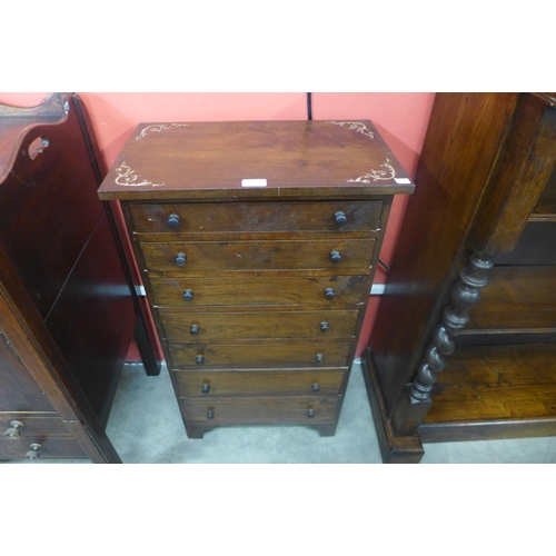 66 - A small French style inlaid mahogany semanier chest of drawers...