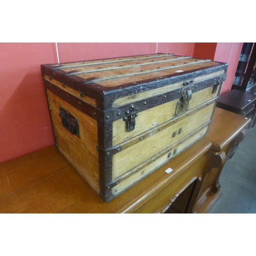 70 - A late 19th/early 20th Century Louis Vuitton pine and iron mounted trunk, lock stamped Louis Vuitton...