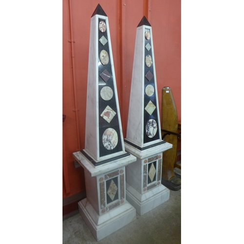 71 - A pair of Italian marble and granite obelisks on pedestals, 188cms h...
