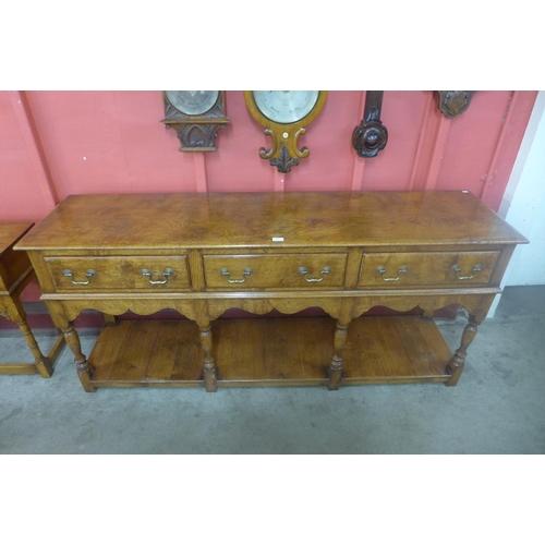 74 - An 18th Century style oak and pollard oak dresser, originally purchased from Furleys of Oakham...