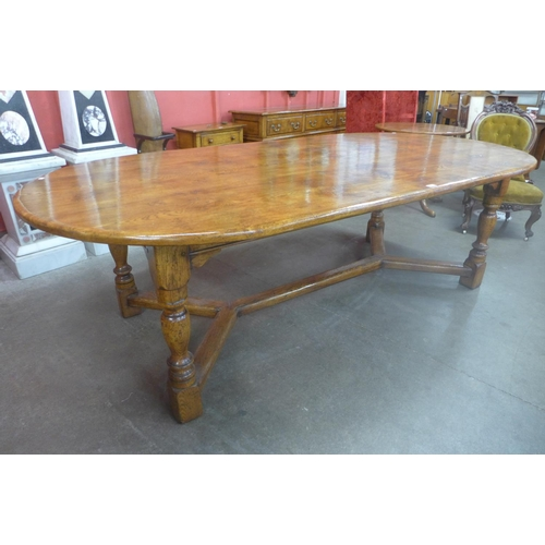 76 - A large 18th Century style oak and pollard oak refectory table, originally purchased from Furleys of...