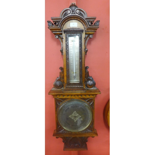 81 - A Victorian carved oak aneroid barometer, the silvered dial signed E. Lennie Optician, Edinburgh...