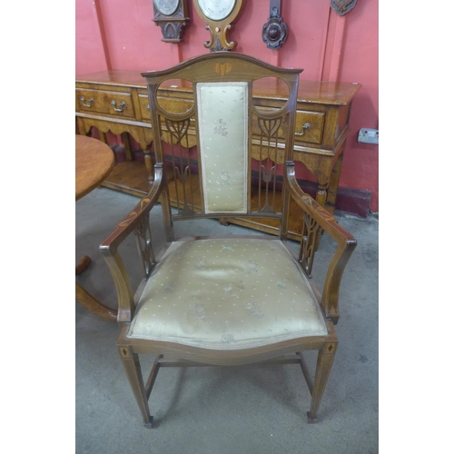 84 - An Arts and Crafts inlaid mahogany elbow chair...
