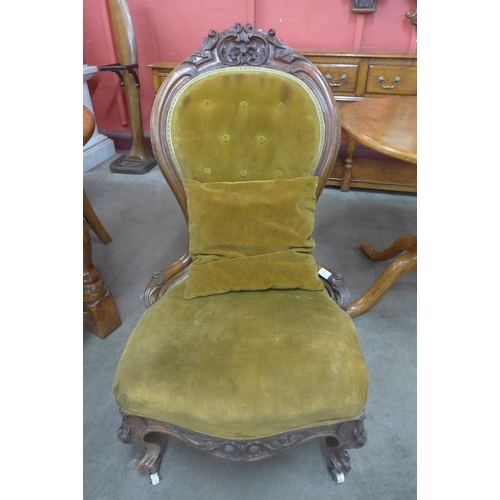 85 - A Victorian carved walnut and upholstered lady's spoonback chair...