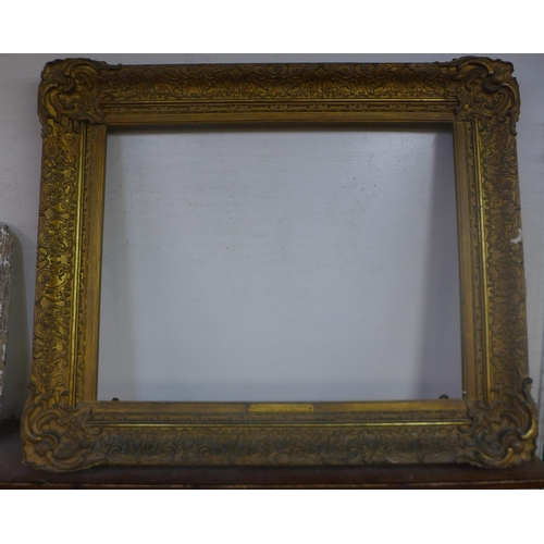 25 - A 19th Century carved giltwood and gesso picture frame, 100 x 120cms (aperture 70 x 90cms)...