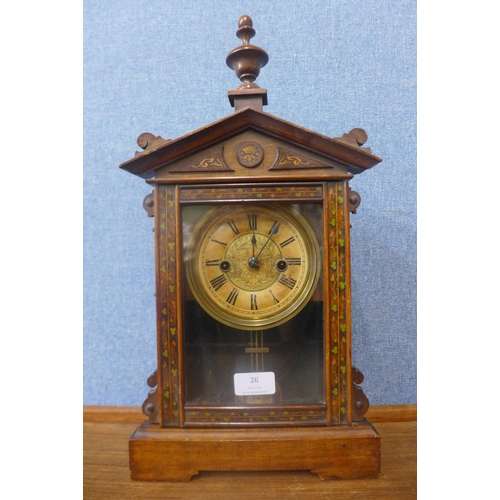 26 - A 19th Century German Wurttemberg walnut mantel clock...