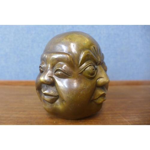 36 - A small bronze four faced Buddha...