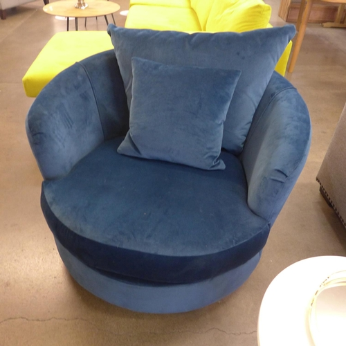 1302 - A blue fabric upholstered circular swivel chair...