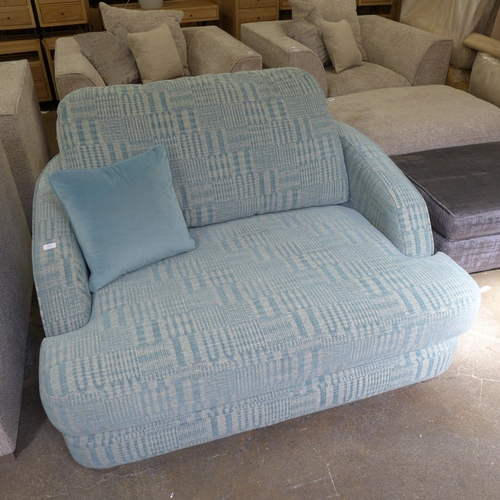 1323 - An aqua marine upholstered love seat...