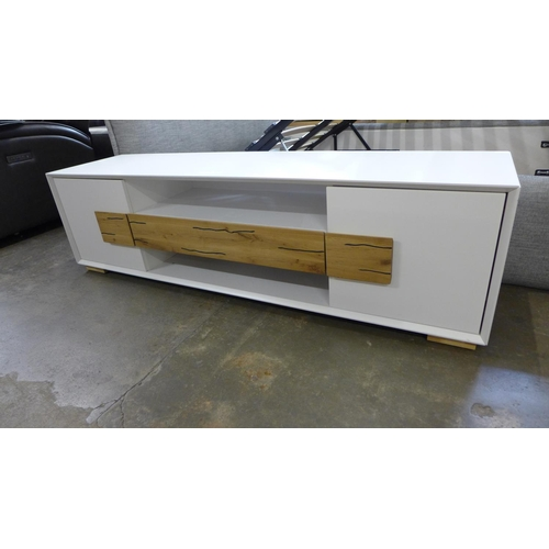 1463 - A two door, one drawer white Orion TV unit - boxed...
