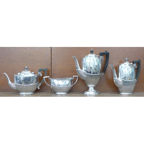 609 - A three piece silver plated tea service and a plated coffee pot...