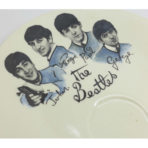 614 - A Beatles 1960's Washington Pottery, cup, saucer and plate...