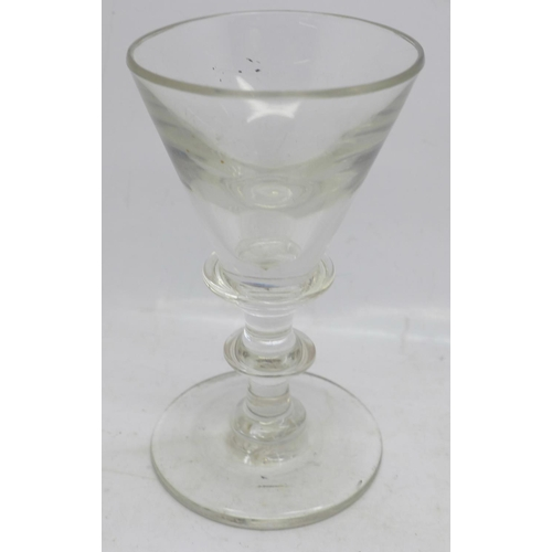 618 - A silver plated wine funnel and a baluster wine glass...