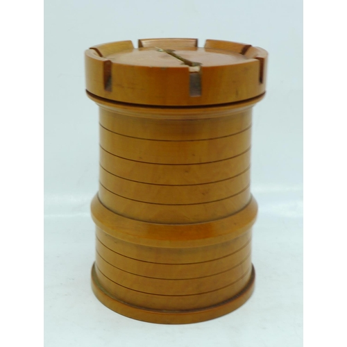 619 - A wooden money box in the form of a chess piece (rook)...