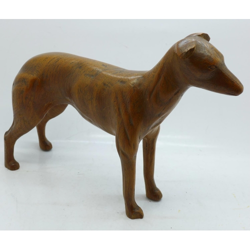 620 - A carved wooden greyhound in the manner of Leopold van Esbroeck, a/f, (ear and paw)...