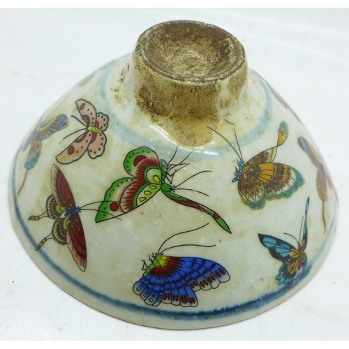 621 - A Chinese Qing Dynasty bowl decorated with butterflies...