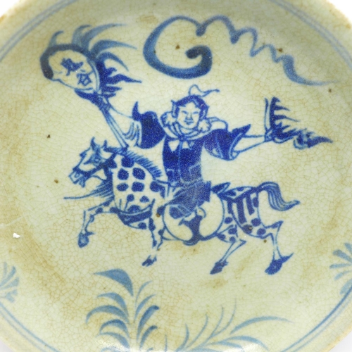 622 - Two Chinese blue and white dishes, one decorated with an immortal on horseback...