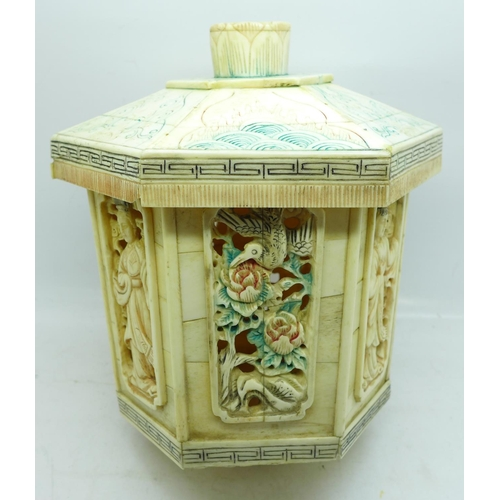 627 - A Chinese carved bone lantern decorated with birds and figures...