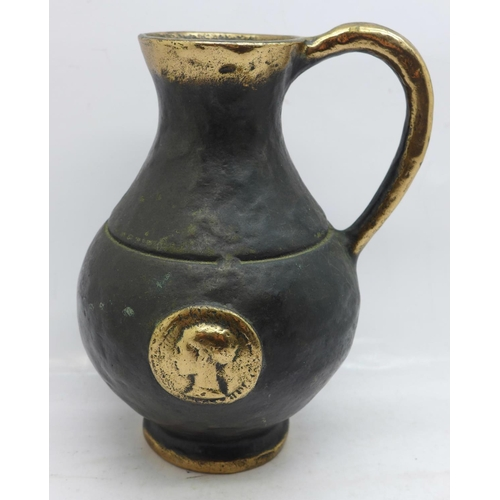 628 - A 17th Century style bronze water jug...