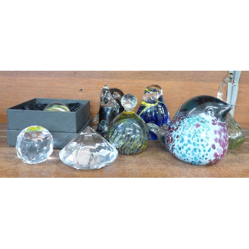635 - A collection of glass paperweights including a M'dina bird group...