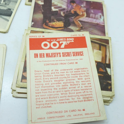 650 - 16 original 1960's James Bond bubble gum cards, On Her Majesty's Secret Service and 8 Thunderball ca...
