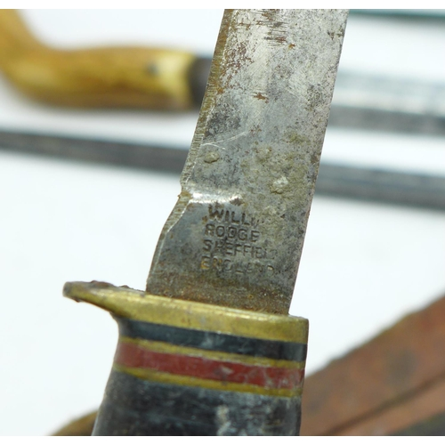657 - A knife marked William Rodgers, with scabbard, one other similar small knife, a dagger with antler h...