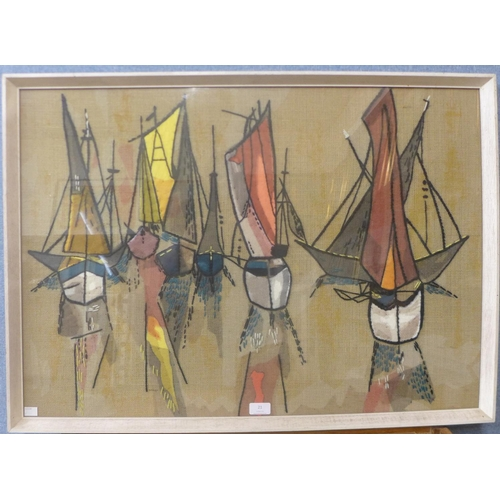 21 - A 1970's tapestry of sailing boats, 59cms x 83cms, framed...