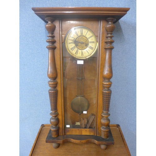 32 - A 19th century walnut Vienna wall clock...