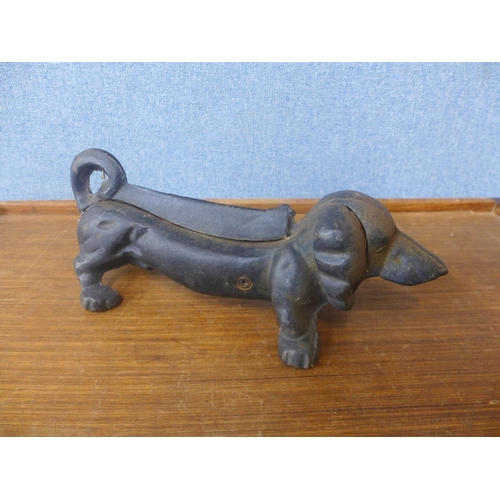 41 - A cast iron doorstop/boot scraper in the form of a Dachshund...