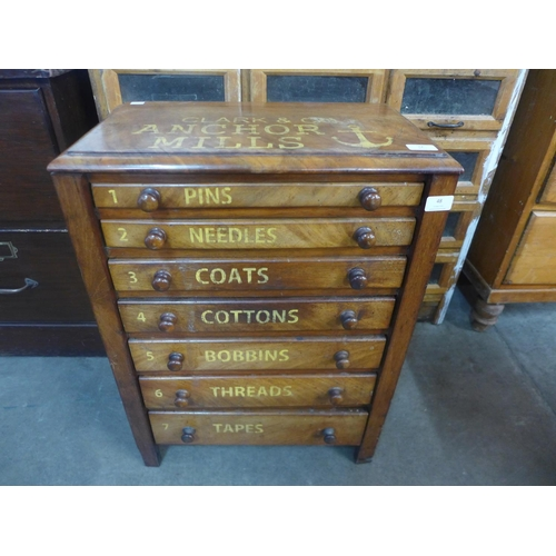 48 - A walnut counter top seven drawer haberdashery chest, bearing Clark & Co., Anchor Mills inscription...