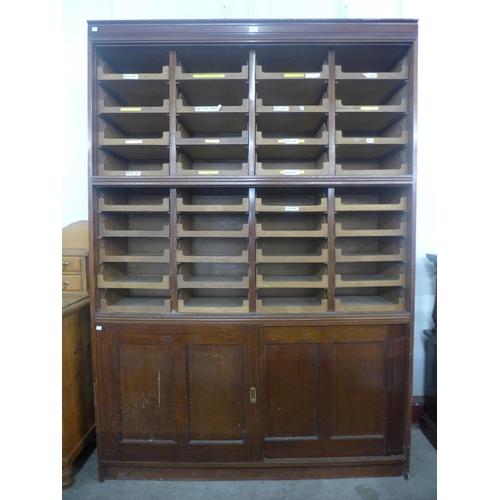 52 - A mahogany haberdashery cabinet (lacking glass sliding doors)...