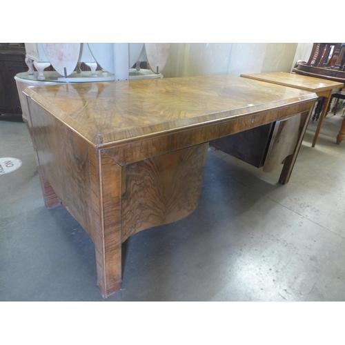 54 - An Art Deco style walnut desk...
