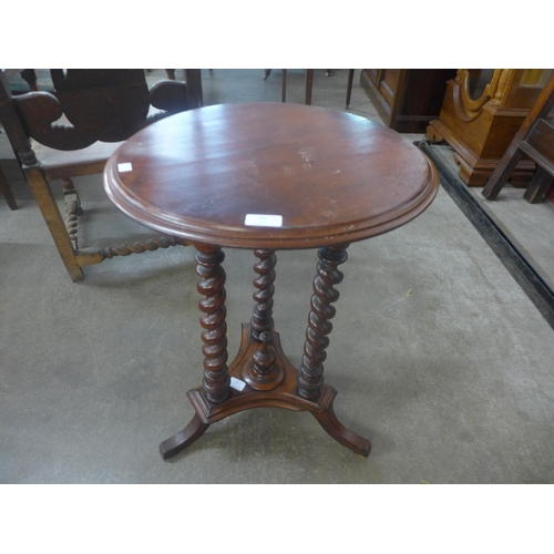 60 - A Victorian mahogany barleytwist wine table...
