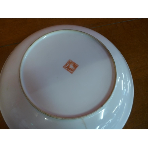 62 - A Chinese bowl on brass stand...