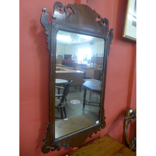 77 - A George III mahogany and parcel gilt wall mirror...