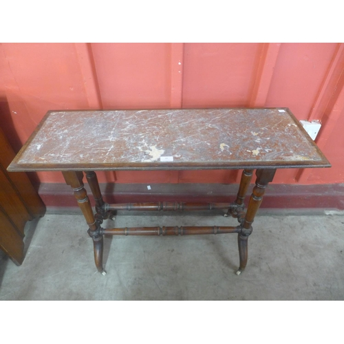 81 - A Victorian mahogany and marble topped console table...