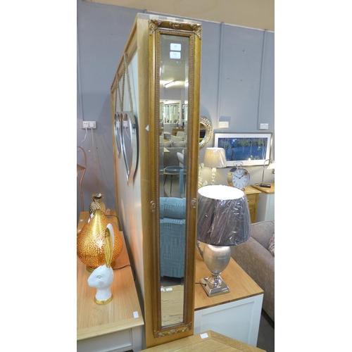 1462 - A slim gilt wall mirror (1534020)   #...