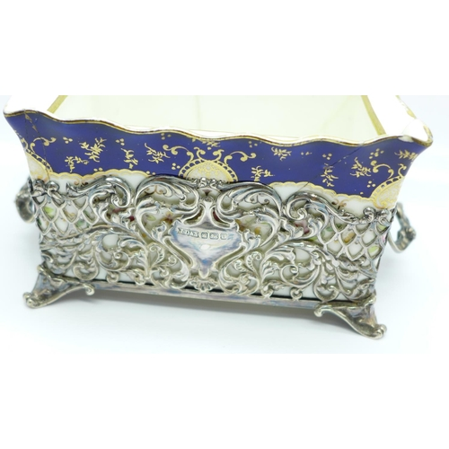 841 - A Coalport silver mounted trinket box or pot pourri, Sheffield 1906, James Dixon, width without hand...