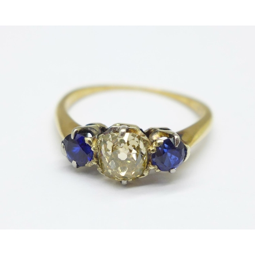 981 - A 9ct gold, diamond and sapphire ring, approximately 0.95carat diamond weight, 2.3g, M...
