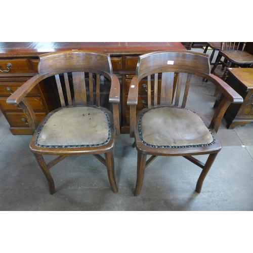 112 - A pair of Victorian oak desk chairs...