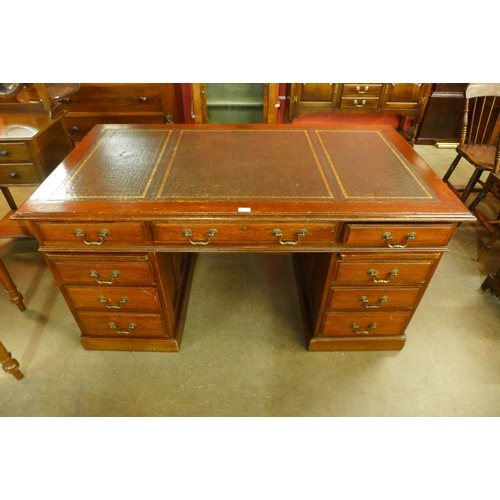 113 - A Victorian oak and leather topped library desk...